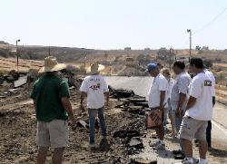 picture raceway staff looking at destruction of track