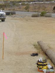Staging lanes fence goes--Entrance logs cut up